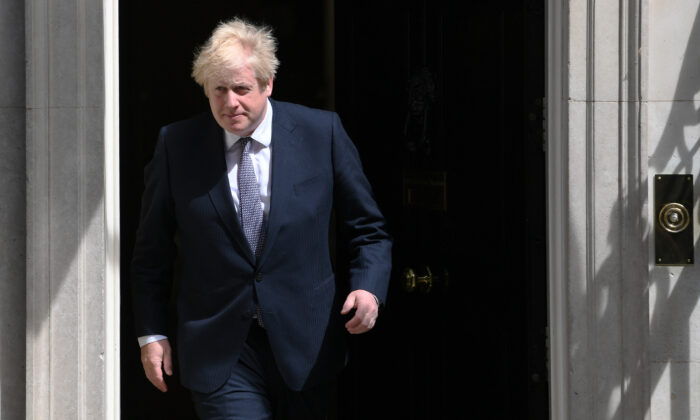 Prime Minister Boris Johnson exits 10 Downing Street in London on June 2, 2021. (Stefan Rousseau/PA)