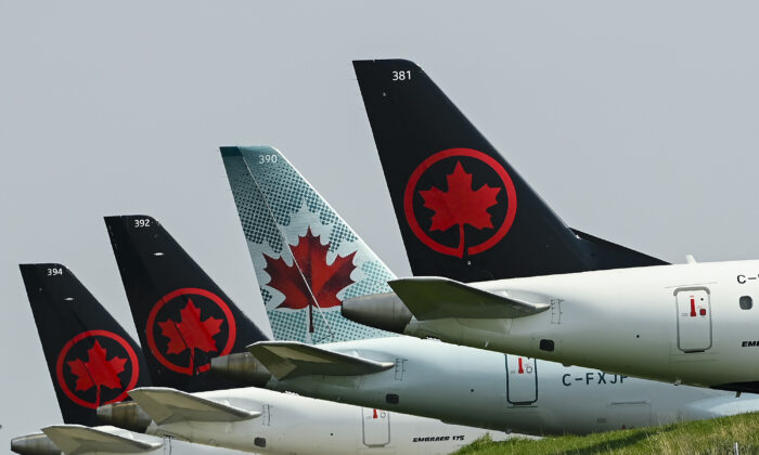 Grounded Air Canada planes sit on the tarmac at Pearson International Airport  during the COVID-19 pandemic in Toronto on Wednesday, April 28, 2021. (The Canadian Press/Nathan Denette)