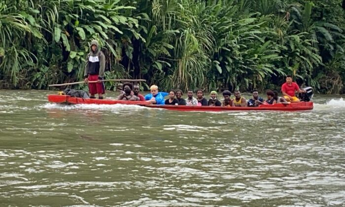 A canoe taking migrants down the Rio Tuquesa to the village La Peñita, Panama on May 27, 2021. (Michael Yon)