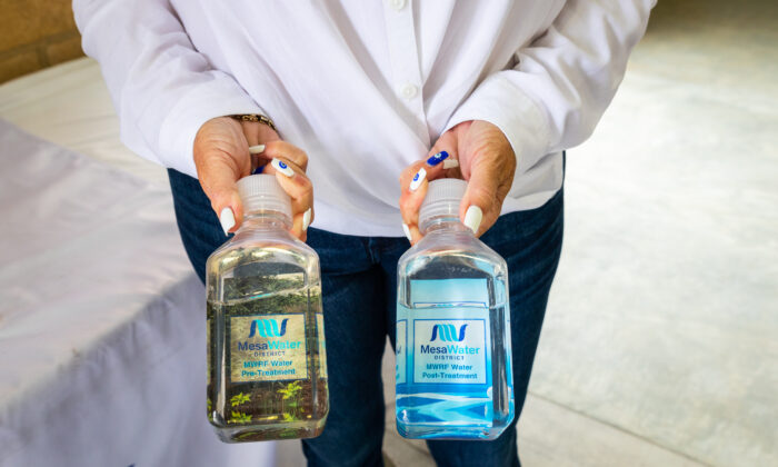 Marice DePasquale, president of Mesa Water District's board of directors, holds samples of water in Costa Mesa, Calif., on June 1, 2021. (John Fredricks/The Epoch Times)