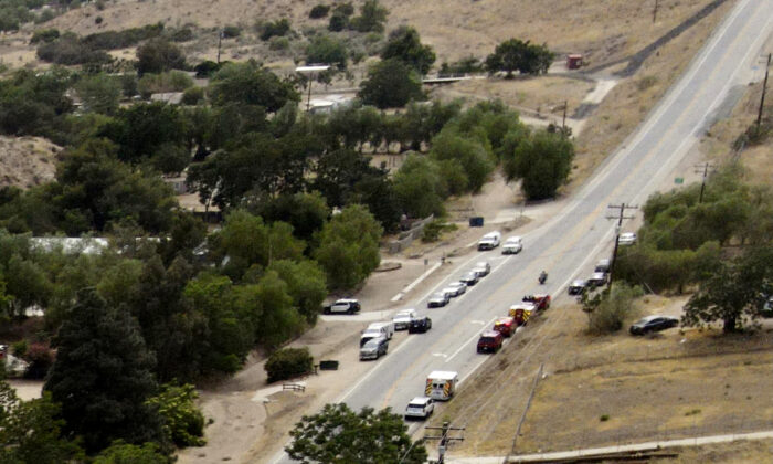 Law enforcement personnel close off a road during an investigation of a shooting at Fire Station 81 in Santa Clarita, Calif., on June 1, 2021. (David Swanson/AP Photo)