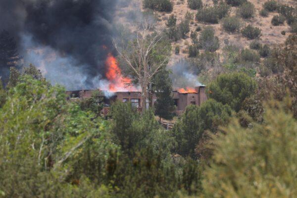 A fire engulfs a house
