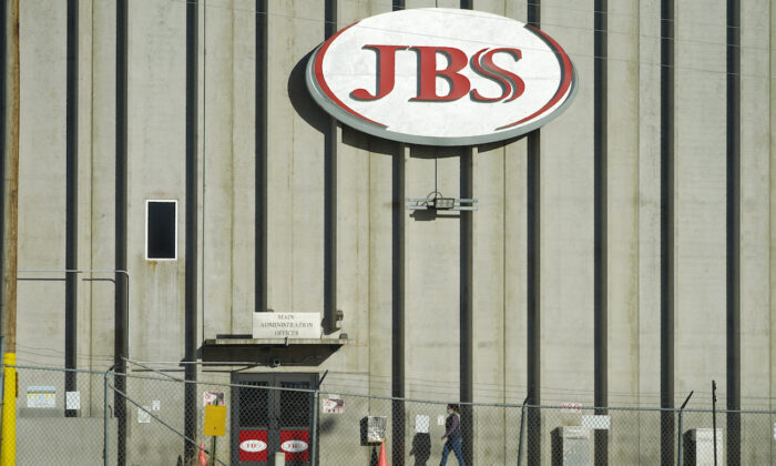 A worker heads into the JBS meatpacking plant in Greeley, Colo., on Oct. 12, 2020. (David Zalubowski/AP Photo)
