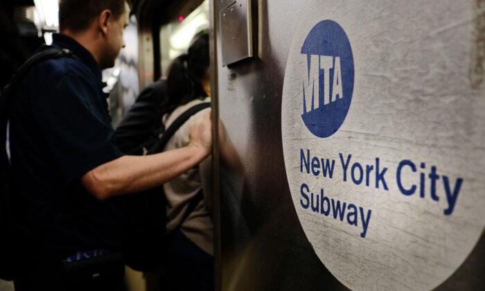 Passengers enter a Metropolitan Transportation Authority (MTA) subway in New York City, N.Y., on June 29, 2017. (Spencer Platt/Getty Images)
