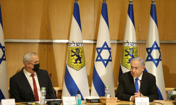 Israeli Prime Minister Benjamin Netanyahu and Minister of Defense Benny Gantz attend a special cabinet meeting on the occasion of Jerusalem Day in Jerusalem, Israel, on May 9, 2021. (Amit Shabi/Pool via Reuters)
