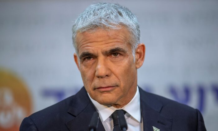 Israeli opposition leader Yair Lapid listens during a news conference in Tel Aviv, Israel on May 6, 2021. (Oded Balilty/AP Photo)