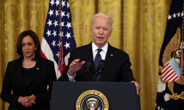 U.S. President Joe Biden gestures during his remarks, as Vice President Kamala Harris looks on, before a signing ceremony for the COVID-19 Hate Crimes Act in the East Room of the White House on May 20, 2021. (Anna Moneymaker/Getty Images).