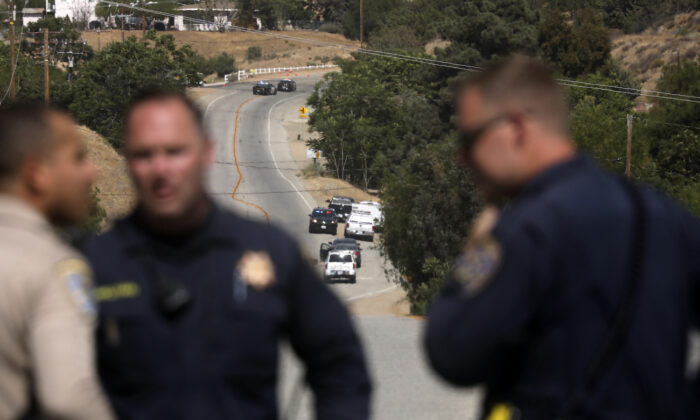 Law enforcement authorities close off a road during an investigation for a shooting at fire station 81 in Santa Clarita, Calif., on June 1, 2021. (David Swanson/AP Photo)