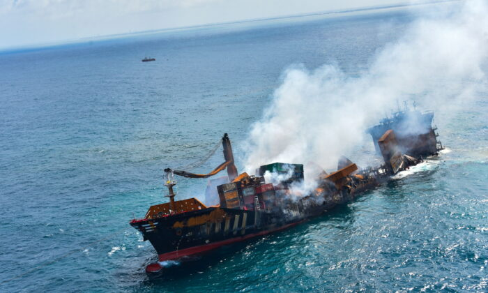 Smoke rises from a fire onboard the MV X-Press Pearl vessel as it sinks while being towed into deep sea off the Colombo Harbour, in Sri Lanka, on June 2, 2021. (Sri Lanka Airforce Media/Handout via Reuters)