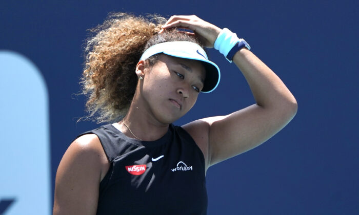 Naomi Osaka, of Japan, reacts during her match against Maria Sakkari, of Greece, in the quarterfinals of the Miami Open tennis tournament in Miami Gardens, Fla., on March 31, 2021. (Lynne Sladky/AP Photo)