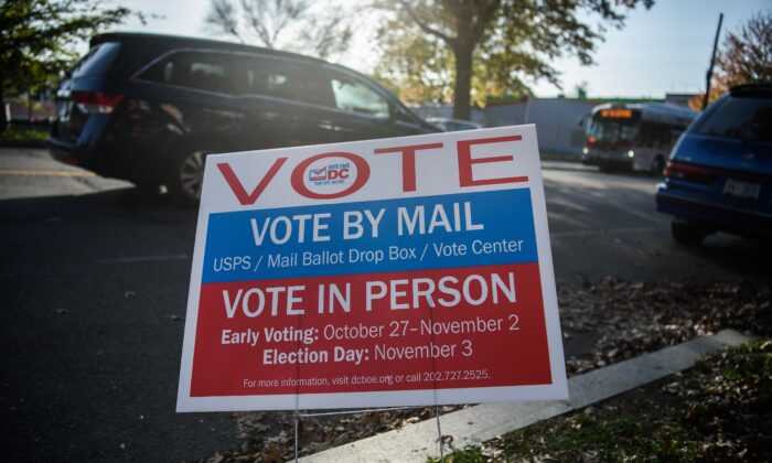 A sign urging people to vote is seen during the U.S. general election in Washington, on Nov. 3, 2020. (Nicholas Kamm/AFP via Getty Images)