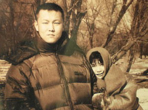 Falun Gong practitioners Yu Zhou and Xu Na. Yu Zhou died as a result of persecution by the Chinese Communist Party. (The Epoch Times)