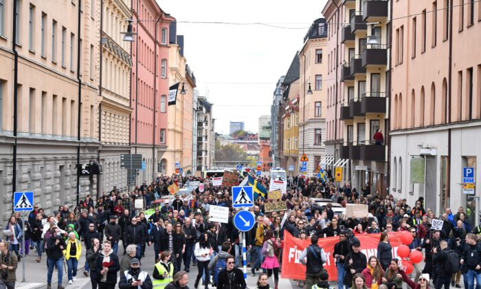 Protestors from Frihet Sverige (Freedom Sweden) march to protest against COVID-19 restrictions, in Stockholm, Sweden, on May 1, 2021. (TT News Agency/Henrik Montgomery via Reuters)