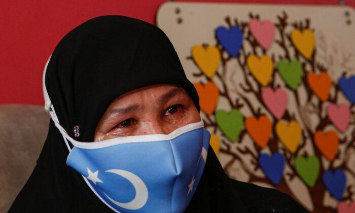 Bumeryem Rozi cries during a media interview at her home, in Istanbul, Turkey, on June 1, 2021. (Mehmet Guzel/AP Photo)