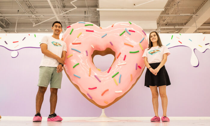 Founders Brian Ross (L) and Kathy Ly stand next to an exhibit in the Donut Life Museum in Westminster, Calif., on May 28, 2021. (John Fredricks/The Epoch Times)