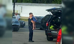 Photo of Alabama Police Officer Comforting Child After Machete Attack Goes Viral