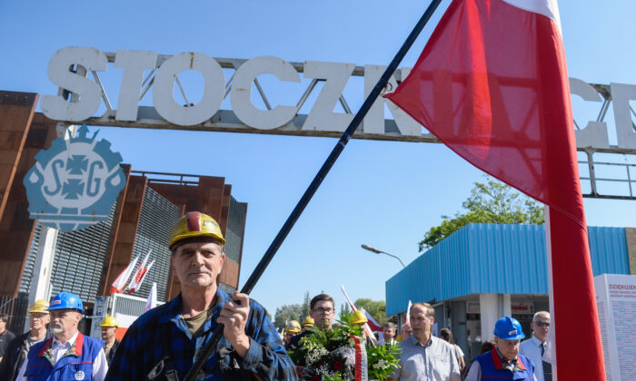 Members of the Solidarity trade union walk by the historical gate of nowadays called Gdansk Shipyard during the 30th Anniversary of partial free elections in Gdansk, Poland, on June 4, 2019. (Omar Marques/Getty Images)