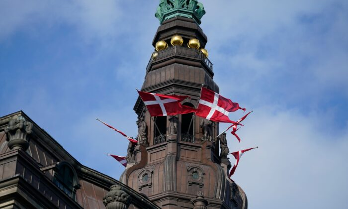 Danish flags (Dannebrog) flutter at Christiansborg Castle in Copenhagen, Denmark, before the official opening of the Danish Parliament, on Oct. 6, 2020. (Mads Claus Rasmussen/Ritzau Scanpix/AFP via Getty Images)