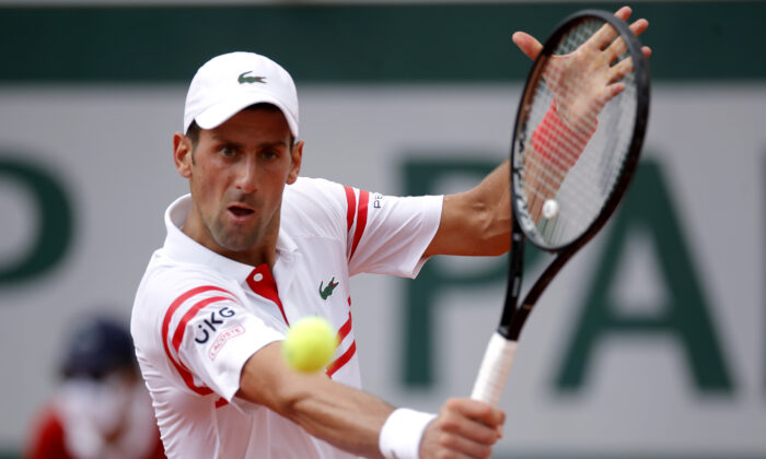 Serbia's Novak Djokovic is in action during his second round match against Uruguay's Pablo Cuevas  during French Open at Roland Garros, Paris, on June 3, 2021. (Sarah Meyssonnier/Reuters)
