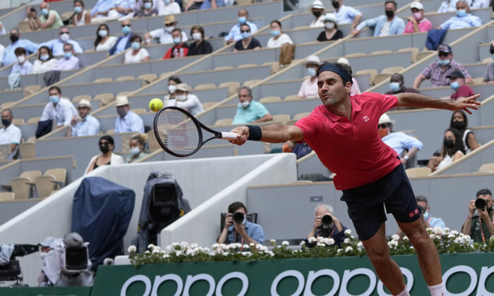 Switzerland's Roger Federer attempts to return serve to Croatia's Marin Cilic during their second round match on day 5, of the French Open tennis tournament at Roland Garros in Paris, France, on June 3, 2021. (Michel Euler/AP Photo)