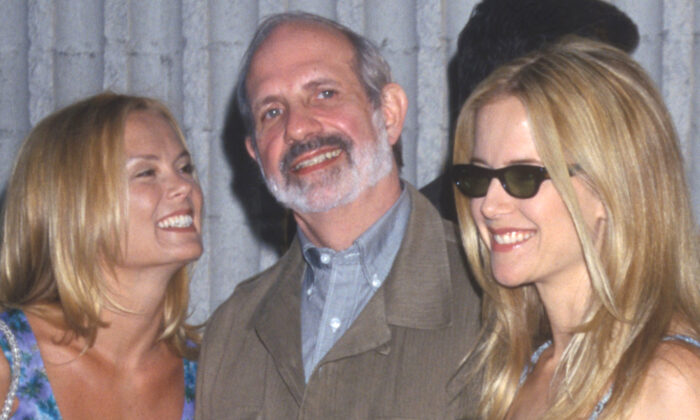 Brian De Palma (C) at the 'Six Days and Seven Nights,' premiere with Romy Walthall (L) and Kelly Preston (R), in Los Angeles, Calif., on June 8, 1998. (Kathy Hutchins/ZUMA Press/TNS)