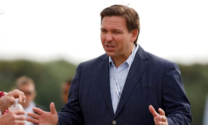 Florida governor Ron DeSantis meets with fans during Day One of The Walker Cup at Seminole Golf Club in Juno Beach, Fla., on May 8, 2021. (Cliff Hawkins/Getty Images)