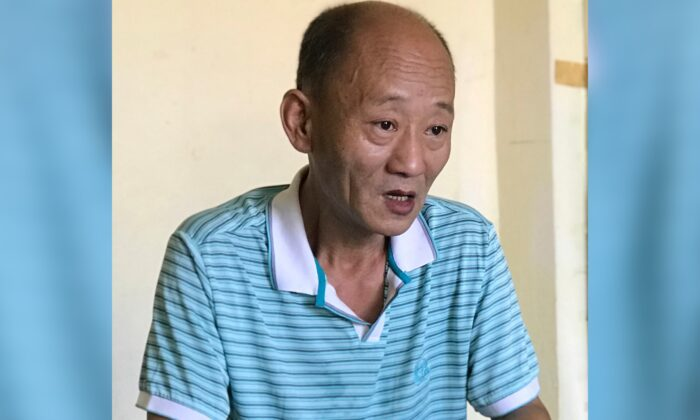 Fan Baolin, who served 17 years in prison and says he sneaked out of China last year to escape constant surveillance, poses during an interview in an undisclosed location and on an undisclosed date. (AP photo)
