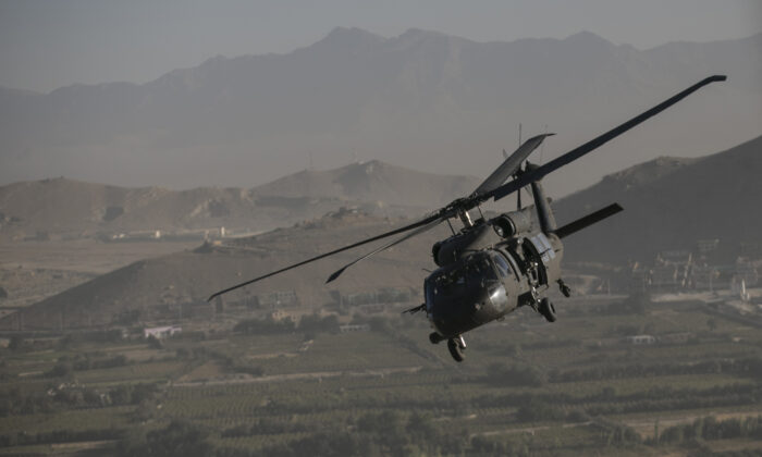 Undated photo showing a Black Hawk helicopter over Kabul in Afghanistan. (Dan Kitwood/AP)
