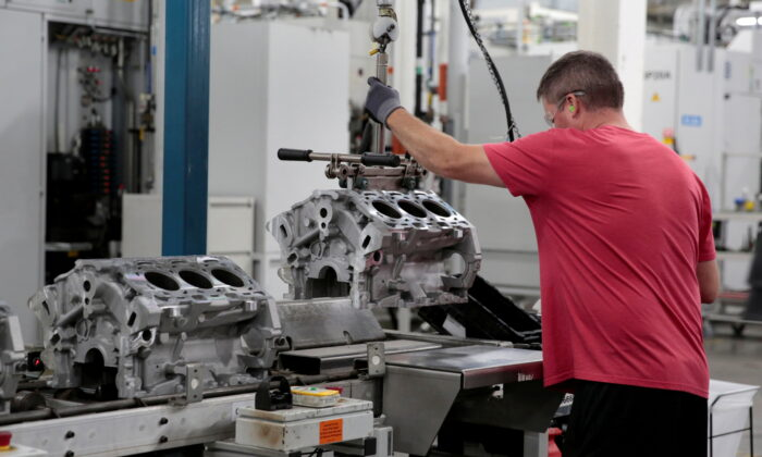 A General Motors assembly worker loads engine block castings on to the assembly line at the GM Romulus Powertrain plant in Romulus, Mich., on Aug. 21, 2019. (Rebecca Cook/File Photo/Reuters)