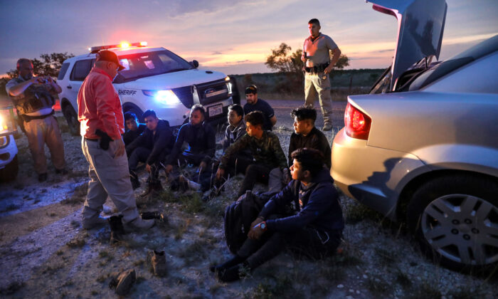 Kinney County Constable Steve Gallegos and Kinney County Sheriff's deputies arrest a smuggler and seven illegal aliens from Guatemala near Brackettville, Texas, on May 25, 2021. (Charlotte Cuthbertson/The Epoch Times)