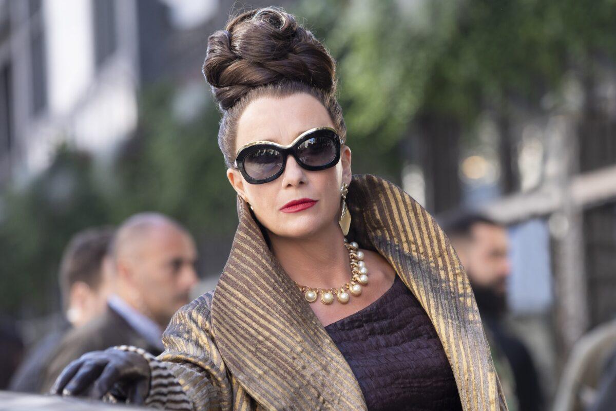 woman with sunglasses in Cruella
