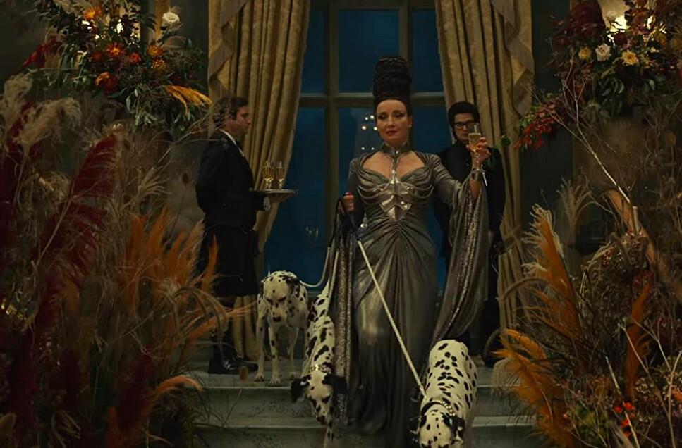 woman with three Dalmations in Cruella
