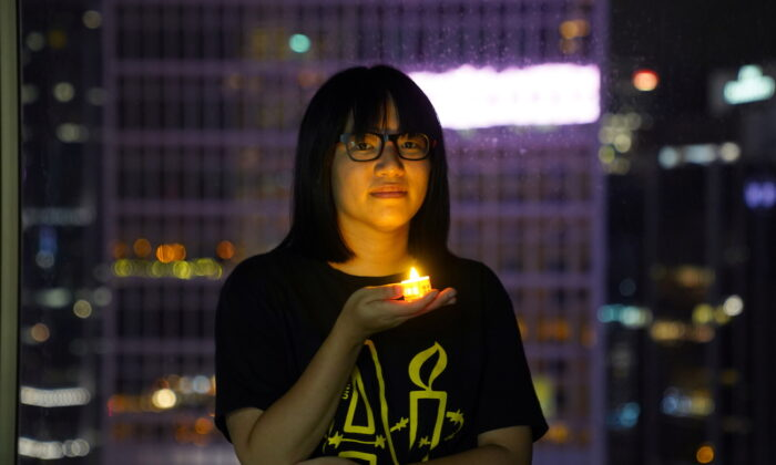 Vice-chairwoman of Hong Kong Alliance in Support of Patriotic Democratic Movements of China, Chow Hang Tung, poses with a candle ahead of the 32nd anniversary of the crackdown on pro-democracy demonstrators at Beijing's Tiananmen Square in 1989, in Hong Kong, on June 3, 2021. (Lam Yik/Reuters)