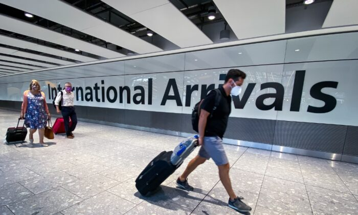 Passengers in the arrivals hall at Heathrow Airport, London, on Aug. 22, 2020. (Aaron Chown/PA)