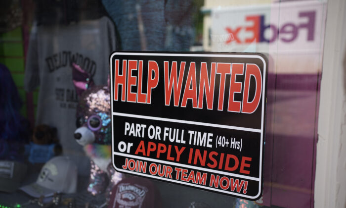 A sign for workers hangs in the window of a shop along Main Street in Deadwood, S.D., on May 26, 2021. (David Zalubowski/AP Photo)