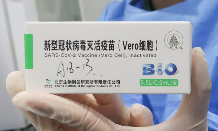 A nurse holds a box of the coronavirus disease (COVID-19) vaccine made by the Beijing Institute of Biological Products, a unit of Sinopharm subsidiary China National Biotec Group (CNBG), at a vaccination center during a government-organized visit, in Beijing, China, on April 15, 2021. (Thomas Peter/File Photo/Reuters)