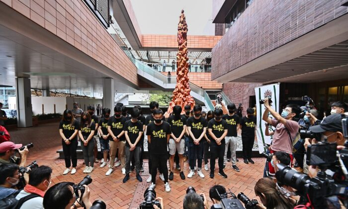 Members of the Hong Kong University Students' Union hold a moment of silence before the Pillar of Shame in Hong Kong on June 4, 2021. (Sung Pi-lung/The Epoch Times)