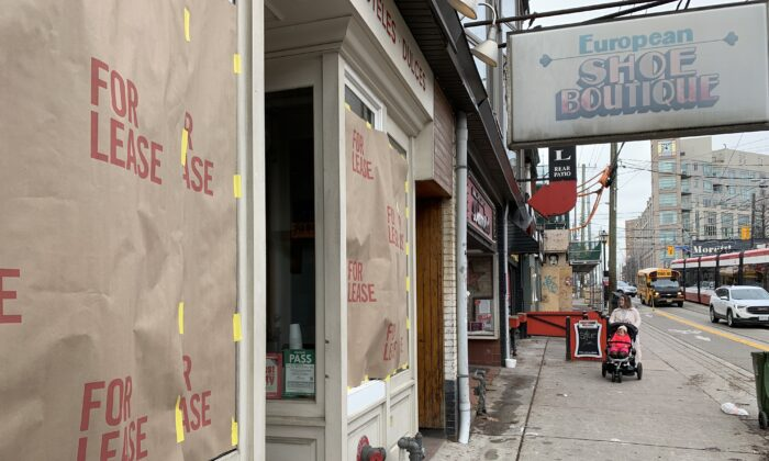 """A storefront on Roncesvalles Avenue in Toronto displays a """"for lease"""" sign as part of a protest against the Ontario government's pandemic lockdown rules, on Nov. 24, 2020. (The Canadian Press/Jody White)"""