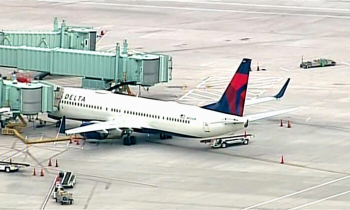 A Delta flight from Los Angeles International Airport bound for Nashville makes an emergency stop in Albuquerque, N.M., after a passenger attempted to breach the cockpit on June 4, 2021. (Courtesy of KOAT)