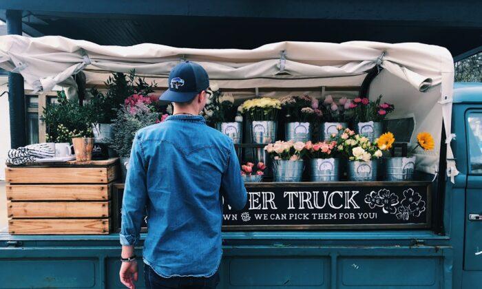 Filling a Florist Flower truck (Cam Morin/Unsplash)