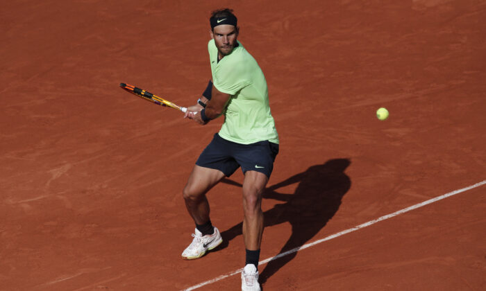 Spain's Rafael Nadal in action during his third round match against Great Britain's Cameron Norrie on day 7 of the 2021 French Open at Roland Garros in Paris, France, on June 5, 2021. (Benoit Tessier/Reuters)