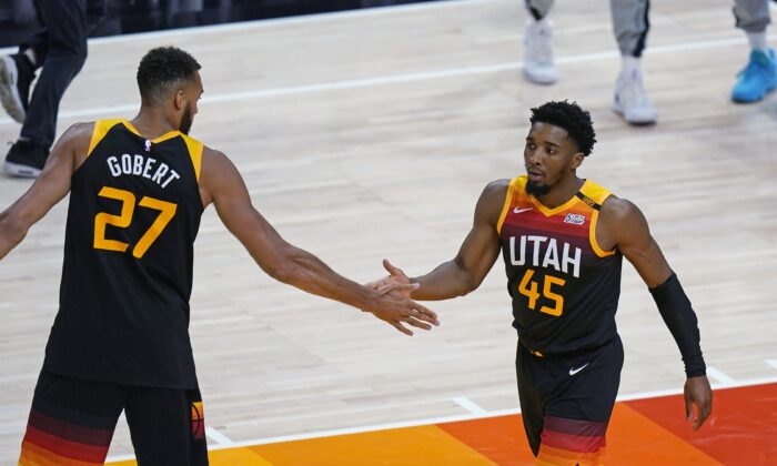 Utah Jazz's Rudy Gobert (27) congratulates Donovan Mitchell (45) after he scored against the Memphis Grizzlies during the first half of Game 5 of an NBA basketball first-round playoff series on June 2, 2021, in Salt Lake City. (Rick Bowmer/AP Photo)