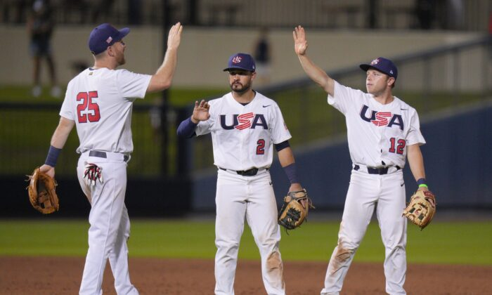 Todd Frazier #25, Eddy Alvarez #2, and Nick Allen #12 of the United States celebrate after defeating Canada by score of 10-1 during the WBSC Baseball Americas Qualifier Super Round at The Ballpark of the Palm Beaches, in West Palm Beach, Fla., on June 4, 2021. (Mark Brown/Getty Images)