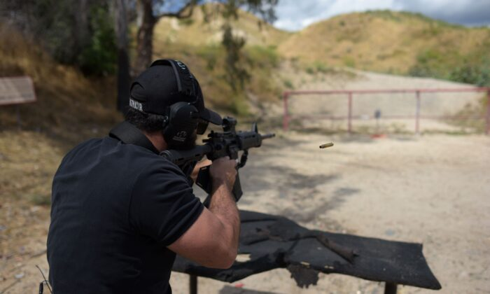 A man shoots an AR-15 style semi-automatic rifle during a demonstration at the Angeles Shooting Ranges in Pacoima, Calif., on May 20, 2019. (Augustin Paullier/AFP via Getty Images)