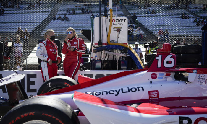 Crew members of Simona De Silvestro, the first female-majority team, stand next to their car prior to the Indianapolis 500 auto race at Indianapolis Motor Speedway in Indianapolis, Ind., on May 30, 2021. (Jeff Dean/AFP via Getty Images)