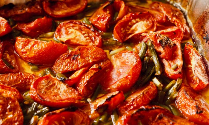 Milder garlic scapes can take the place of garlic in early summer roasted tomatoes. (Dreamstime/TNS)