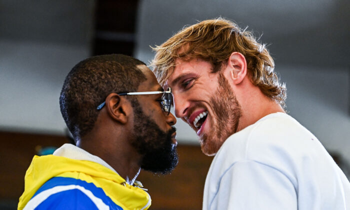 Former world welterweight king Floyd Mayweather (L) and YouTube personality Logan Paul face-off during the media availability ahead of their June 6 exhibition boxing match, at Villa Casa Casuarina at the former Versace Mansion in Miami Beach, Fla., on June 3, 2021. (Chandan Khanna/AFP via Getty Images)