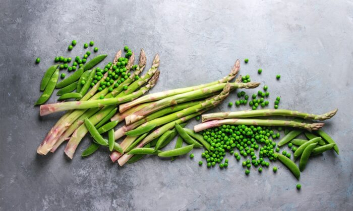 Asparagus and peas go together beautifully, but feel free to add your own favorites to this veggie medley. (Natasha Breen/shutterstock)
