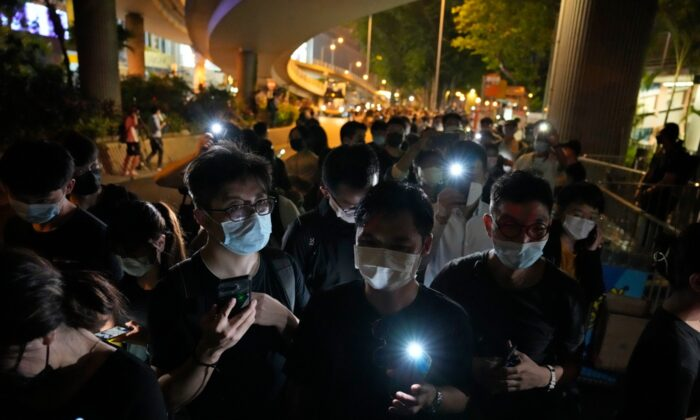 People light LED candles to mark the anniversary of the massacre of a pro-democracy student movement in Beijing, outside Victoria Park in Hong Kong, on June 4, 2021. (Kin Cheung/AP Photo)