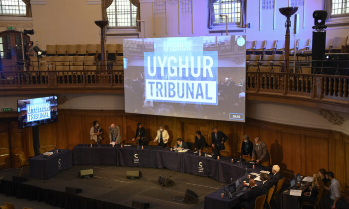 Members of the Panel of the independent Uyghur Tribunal take their seats for the first session of the hearings at Church House, in London, UK, on June 4, 2021. (Alberto Pezzali/AP Photo)